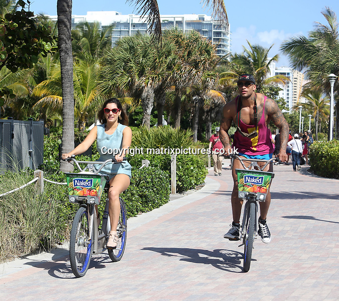 NON EXCLUSIVE PICTURE: KEYPIXX / MATRIXPICTURES.CO.UK<br /> PLEASE CREDIT ALL USES<br /> <br /> UK, AUSTRALIA, NEW ZEALAND AND ASIA RIGHTS ONLY<br /> <br /> English model and media personality Kelly Brook is pictured with her boyfriend, British model and ex Gladiator David McIntosh, while holidaying at Miami Beach in Florida, USA.<br /> <br /> The loved-up pair are seen riding bikes and doing fitness exercises on the beach before changing into their swim wear and taking a dip in the sea.<br /> <br /> FEBRUARY 3rd 2014<br /> <br /> REF: KDA 14578<br /> <br /> GS