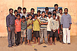 Children who work as scavengers in the municipal dump in Chennai, India, are hosted in a night shelter by the Madras Christian Council of Social Service. Three adults who work with the boys are also pictured.