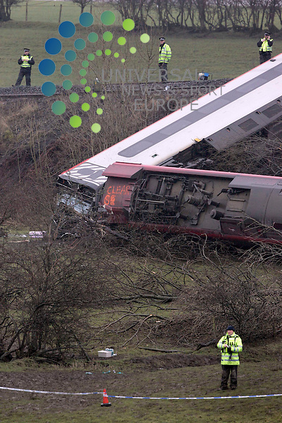 Rail Inspectors looking at his train after elderly a woman has died and five other passengers have been seriously hurt in a train derailment in Cumbria..Several carriages were left on their side after the 1715 Virgin train from London to Glasgow Central crashed at Grayrigg, near Kendal, at 2015 GMT..Maurice McDonald Universal News/Photo.