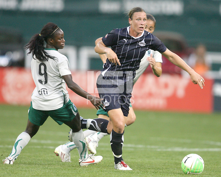 Abby Wambach #20 of the Washington Freedom moves away from Eniola Aluko #9 and Niki Cross #21 of St. Louis Athletica during a WPS match on May 1 2010, at RFK Stadium, in Washington D.C. Freedom won 3-1.