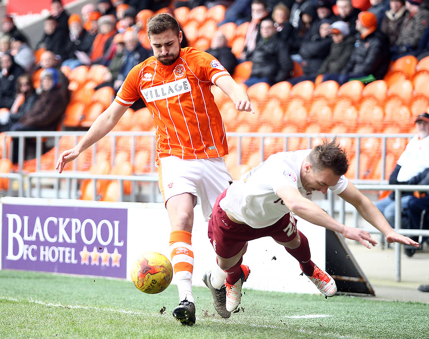 Bradford City's Anthony McMahon goes down under the challenge from Blackpool's Clark Robertson<br /> <br /> Photographer Rich Linley/CameraSport<br /> <br /> Football - The Football League Sky Bet League One - Blackpool v Bradford City - Saturday 27th February 2016 - Bloomfield Road - Blackpool   <br /> <br /> &copy; CameraSport - 43 Linden Ave. Countesthorpe. Leicester. England. LE8 5PG - Tel: +44 (0) 116 277 4147 - admin@camerasport.com - www.camerasport.com