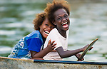 Girls in a dugout canoe in the Katupika community are happy to see visitors.