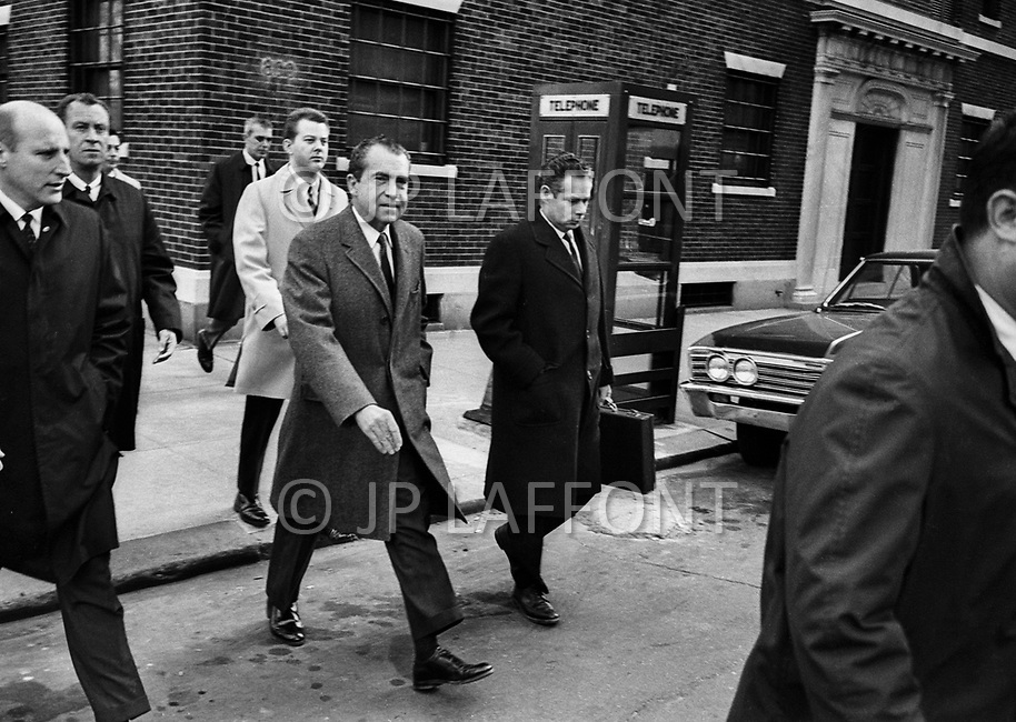 Manhattan, NYC, November, 1970 - Richard Nixon leaving his apartment on 5th avenue, walking over to hotel Pierre for a meeting, surrounded by his bodyguards.