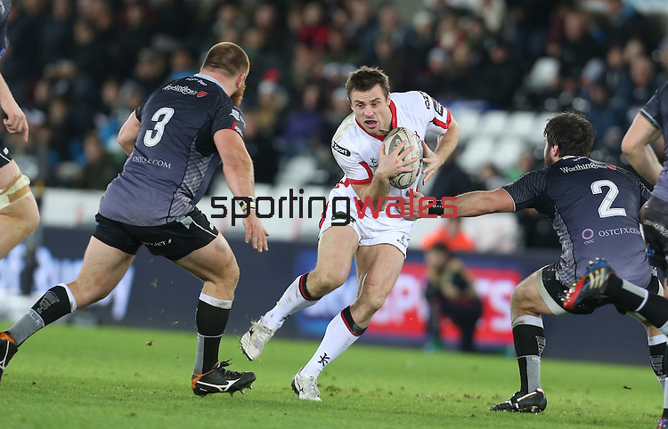 Ulster wing Tommy Bowe goes for the gap between Ospreys pair Dmitri Arhip and Scott Baldwin.<br /> Guiness Pro12<br /> Ospreys v Ulster<br /> 20.12.14<br /> ©Steve Pope -SPORTINGWALES