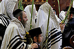 Israel, Bnei Brak. Succot holiday at the Premishlan congregation. The Rebbe and his hassids with the Four Species<br />