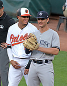 Baltimore Orioles shortstop Manny Machado (13) converses with New York Yankees first baseman Greg Bird (33) after reaching base on a single in the first inning at Oriole Park at Camden Yards in Baltimore, MD on Tuesday, July 10, 2018.<br /> Credit: Ron Sachs / CNP<br /> (RESTRICTION: NO New York or New Jersey Newspapers or newspapers within a 75 mile radius of New York City)