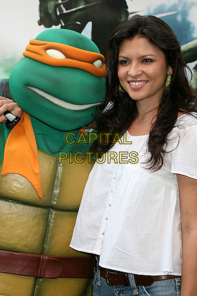 "TURTLE & ERICA MUNOZ.""TMNT"" (aka. ""Teenage Mutant Ninja Turtles"") Los Angeles Premiere at Grauman's Chinese Theatre, Hollywood, California, USA, 17 March 2007..half length turtle costume dressed-up.CAP/ADM/BP.©Byron Purvis/AdMedia/Capital Pictures."