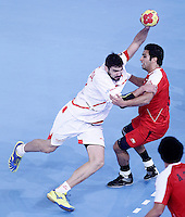Egypt's Islam Hassan (r) and Spain's Jorge Maqueda Pena during 23rd Men's Handball World Championship preliminary round match.January 14,2013. (ALTERPHOTOS/Acero) /NortePhoto