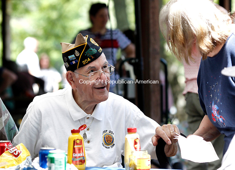 Southbury, CT- 26 May 2014-052614CM13- Vincent DaGrosa, a veteran of World War II and commander of American Legion Post 204 chats with Karen Owsiany, of Oxford during Southbury's  annual town picnic at Ballantine Park in Southbury.   Christopher Massa Republican-American