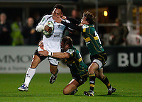 Photo: Richard Lane/Richard Lane Photography. Northampton Saints v Castres Olympique. Heineken Cup. 08/10/2010. Castres' Chris Masoe is tackled by Saints' Roger Wilson and Lee Dickson.