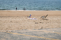 People walk along the beach at Herring Cove Beach in the Cape Cod National Seashore outside of Provincetown, Mass., USA, on Fri., July 1, 2016. at Herring Cove Beach in the Cape Cod National Seashore outside of Provincetown, Mass., USA, on Fri., July 1, 2016. Portions of the parking lot have been closed after land eroded during storms earlier this year.