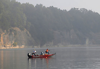 NWA Democrat-Gazette/FLIP PUTTHOFF <br /> FOGGY FISHING MORNING<br /> Anglers fish Tuesday Sept. 29 2015 near a bluff at Bear Island on Beaver Lake. Fog shrouded the lake early on Tuesday.