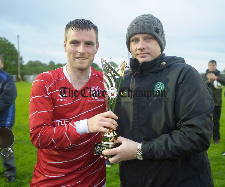 David Mc Carthy of Newmarket Celtic gets the man of the match award following their Cup final win over Bridge United at Doora. Photograph by John Kelly.