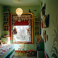 A child's bedroom with murals and other visual stimuli