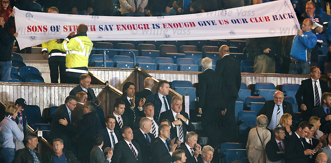 Rangers CEO Graham Wallace remains stoic as the Sons of Struth keep the pressure on the board of directors
