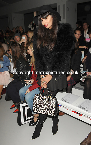NON EXCLUSIVE PICTURE: PAUL TREADWAY / MATRIXPICTURES.CO.UK<br /> PLEASE CREDIT ALL USES<br /> <br /> WORLD RIGHTS<br /> <br /> British television personality and model Jameela Jamil attends the Holly Fulton catwalk show during London Fashion Week S/S 2014 in London.<br /> <br /> 14TH SEPTEMBER 2013<br /> <br /> REF: PTY 136114