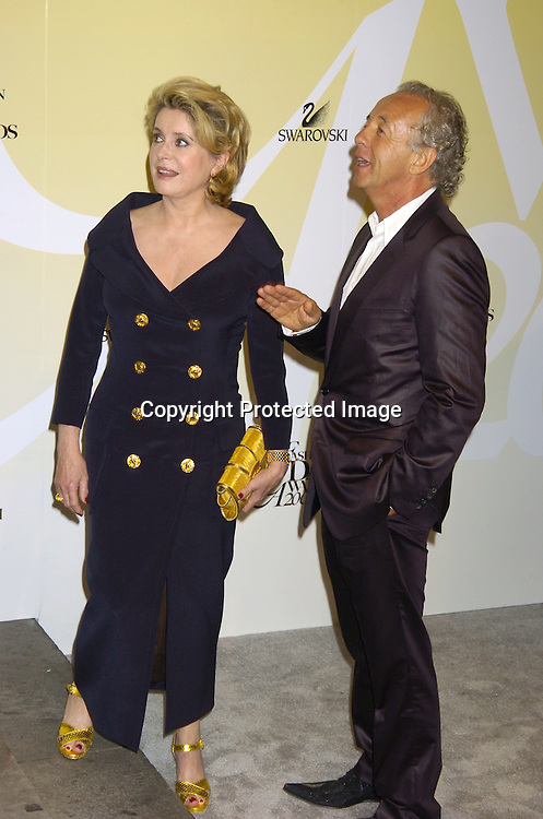 Catherine Deneuve and Gilles Bensimon ..at the 2005 CFDA Fashion Awards on June 6, 2005 at ..the New York Public Library. ..Photo by Robin Platzer, Twin Images