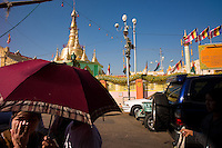 Vendors, worshippers and neighborhood residents circulate on the streets outside the historic Botataung Paya in Yangon, Union of Myanmar (Burma). The pagoda is said to house several strands of the Buddha's hair, brought by pilgrims from India 2,000 years ago...EDS: Not for syndication nor redistribution. Web slide show only. Please do not strip metadata for Web use..