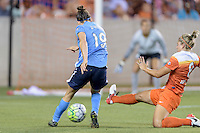 Ellie Brush (8) of the Houston Dash attempts to block a shot by Kelley O'Hara (19) of Sky Blue FC at BBVA Compass Stadium. The Houston Dash tied Sky Blue FC 0-0.