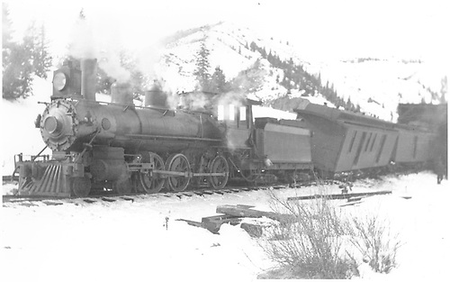 3/4 fireman's-side view of D&amp;RG #171 with at least the first car of her passenger train derailed at Coxo snowshed.<br /> D&amp;RG  Coxo, CO