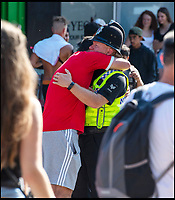BNPS.co.uk (01202 558833)<br /> Pic: LeeMcLean/BNPS<br /> <br /> Policeman consoles an over emotional fan.......<br /> <br /> Sizzling Saturday in Bournemouth as football fever gripped the seaside resort, with fans havng to resort to peering in windows as all the bars were full.