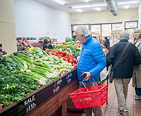 Shoppers at the newly reopened Stile's Farmers Market in the Hell's Kitchen neighborhood of New York on Sunday, May 7, 2017. After being forced out from their original location, where it had been tor over 20 years, almost three years ago because the building was sold and developed the popular market, known for its affordability and quality produce, has reopened a few blocks down from its original location on Ninth Avenue. (© Richard B. Levine)