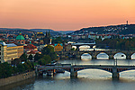 Scenic sunset aerial view of the Old Town pier architecture and Charles Bridge over Vltava river in Prague, Czech Republic