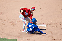Philadelphia Phillies shortstop Luis Garcia (5) tags Hugo Cardona (4) as he slides into second base during a Florida Instructional League game against the Toronto Blue Jays on September 24, 2018 at Spectrum Field in Clearwater, Florida.  (Mike Janes/Four Seam Images)
