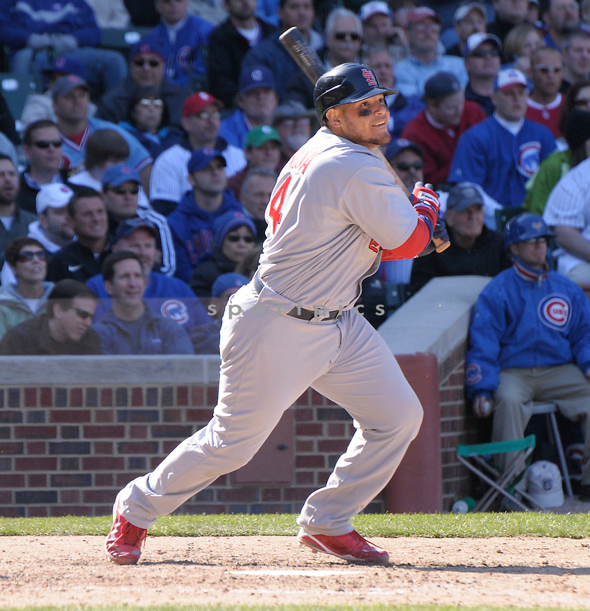 YADIER MOLINA, of the St. Louis Cardinals  , in action  during the Cardinals  game against the Chicago Cubs  on April 16, 2009 in Chicago, IL.  The Cubs beat  the Cardinals  8-7  in Chicago,