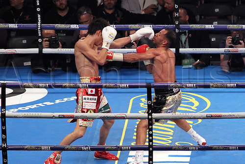 28th October 2017, Principality Stadium, Cardiff, Wales; World Heavyweight Boxing, Anthony Joshua versus Carlos Takam, Undercard fight;  Kal Yafai Versus Sho Ishida for WBA super flyweight world championship; Sho Ishida sends Kal Yafai's head back with a straight left hand