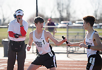 NWA Democrat-Gazette/CHARLIE KAIJO Bentonville High student Cameron Dalton (left) takes the baton from Prayden Wilkins during the Tiger Relays track meet, Friday, March 16, 2018 at the Tiger Athletic Complex in Bentonville.
