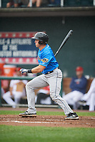 Akron RubberDucks catcher Daniel Salters (11) hits a single during a game against the Harrisburg Senators on August 19, 2018 at FNB Field in Harrisburg, Pennsylvania.  Akron defeated Harrisburg 3-0 in a rain shortened game.  (Mike Janes/Four Seam Images)