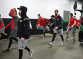 Brien Diffley (BU - 20), Matt Grzelcyk (BU - 5), Chase Phelps (BU - 12), Anthony Morando (BU - Assistant Strength/Cond Coach), Matt O'Connor (BU - 29), Connor LaCouvee (BU - 30) - The Boston University Terriers warmed up prior to the Frozen Four final at TD Garden on Saturday, April 11, 2015, in Boston, Massachusetts.
