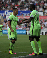 ( L-R ) Sergio Aguero of Manchester City substituted by Yaya Toure during the Swansea City FC v Manchester City Premier League game at the Liberty Stadium, Swansea, Wales, UK, Sunday 15 May 2016