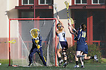 Santa Barbara, CA 02/19/11 - Emmy Scheidt (Michigan #11), Louise Marquino (UC Davis #8) and Maddie Sullivan (Michigan #18) in action during the Michigan-UC Davis game at the 2011 Santa Barbara Shootout.