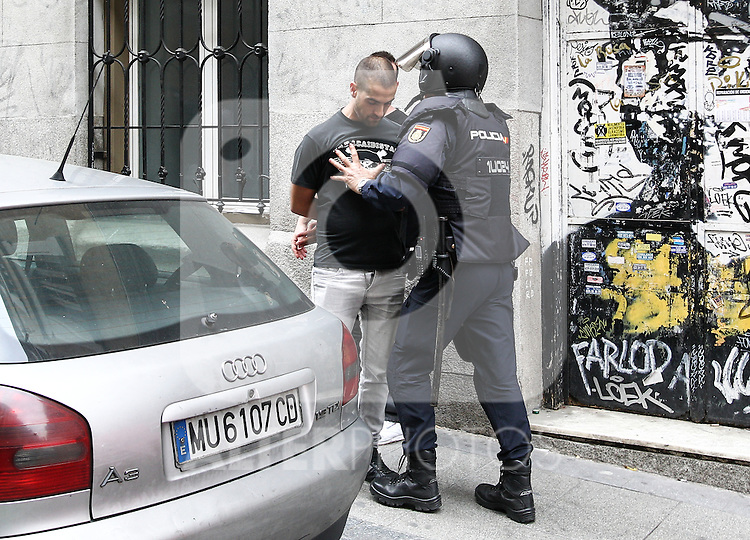 """Police had to stop any member of the manifestation of far-right group , Hogar Social Madrid under the slogan """" Defend Spain , defend your people """", in the streets of Gran Via , San Bernardo and Plaza Dos de Mayo.  May 21, 2016. (ALTERPHOTOS/Rodrigo Jimenez)"""