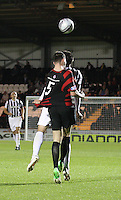 Steven Thompson (hidden) and Darren Brownlie tussle in the St Mirren v Ayr United Scottish Communities League Cup match played at St Mirren Park, Paisley on 29.8.12.