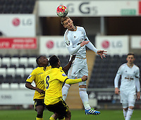 Pictured: Jay Fultopn of Swansea heads the ball forward Monday 25 April 2016<br /> Re: Play Off semi final, Swansea City AFC U21 v Aston Villa FC U21 at the Liberty Stadium, Swansea, UK