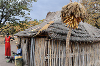 SOUTH-SUDAN Rumbek , village, Colocok, Dinka hut with with Sorghum and maize storage / SUED SUDAN, Rumbek,  Dinka Dorf Colocok, Huette aus Bambus und Stroh mit Sorghum und Mais Speicher