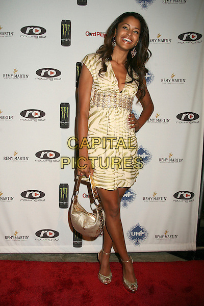 CLAUDIA JORDAN.2nd Annual Celebrity Poker Tournament Benefiting The Urban Health Institute at the Playboy Mansion, Holmby Hills, California, USA..April 28th, 2007.full length dress animal print hand on hip gold beige silver purse bag .CAP/ADM/BP.©Byron Purvis/AdMedia/Capital Pictures