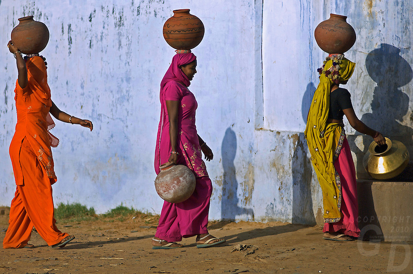 On the road from Mandava to Delhi, India, young women collecting water