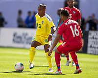 CLEVELAND, OH - JUNE 22: Neil Danns #16 passes the ball as he is defended by Rolando Blackburn #16 during a game between Panama and Guyana at FirstEnergy Stadium on June 22, 2019 in Cleveland, Ohio.