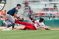Fresno Grizzlies shortstop Carter Kieboom (8) slides into third base for a triple in front of Kevin Cron (35) during a game against the Reno Aces at Chukchansi Park on April 8, 2019 in Fresno, California. Fresno defeated Reno 7-6. (Zachary Lucy/Four Seam Images)