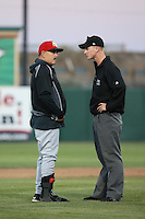High Desert Mavericks Manager Howard Johnson (20) discusses a call with umpire Brandon Butler during a game against the Lancaster JetHawks at The Hanger on April 16, 2016 in Lancaster, California. Lancaster defeated High Desert, 3-2. (Larry Goren/Four Seam Images)