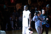 A television crew and the Madison Square Garden spotlight focus on Eric Boateng (C) during player presentation for the Jordan Classic game in New York City, United States, 16 April 2005.