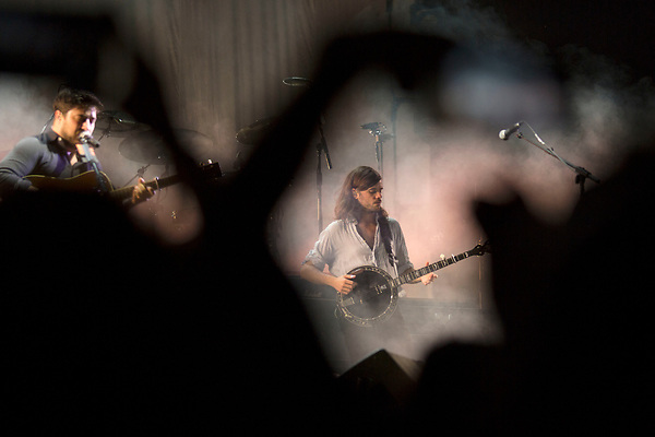 Mumford and Sons, seen through the arms of fans shooting cell phone video finish off the night at Music Midtown Sunday.