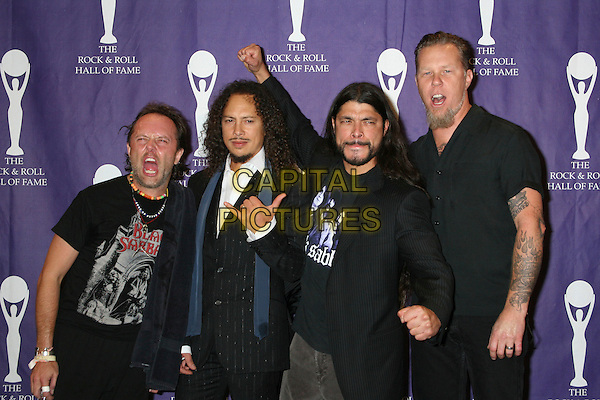 LARS ULRICH, KIRK HAMMETT, ROBERT TRUJILLO & JAMES HETFIELD - METALLICA.21st Annual Rock and Roll Hall of Fame Induction Ceremony at the Waldorf Astoria in New York City, New York, USA..March 13th, 2006.Ref: IW.half length black hand gesture tattoos.www.capitalpictures.com.sales@capitalpictures.com.©Capital Pictures