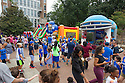 Duke faculty, staff and their kids crowd around the inflatables and other games in the Employee Fun Zone area before the season opener against North Carolina Central University. Duke won the game 49-6 at the newly renovated Brooks Field at Wallace Wade Stadium.