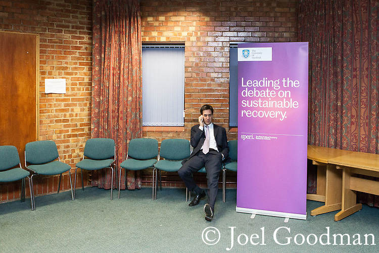 "© Joel Goodman - 07973 332324 . 09/02/2012 . Salford , UK . Labour Party leader ED MILIBAND backstage ahead of delivering a speech on the "" Sustainable Recovery "" to students and visitors at Sheffield University . A banner reads "" Leading the debate on sustainable recovery "". Photo credit : Joel Goodman"