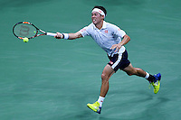 NEW YORK, USA - SEPT 09, Kei Nishikori of Japan returns a shot against Stan Wawrinka of Switzerland during their Men's Singles Semifinal Match of the 2016 US Open at the USTA Billie Jean King National Tennis Center on September 9, 2016 in New York.  photo by VIEWpress